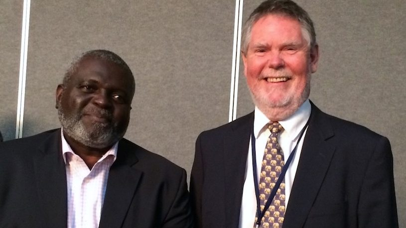 Philip Dearden with Devon Rowe, Executive Director of the Caribbean Centre for Development Administration CARICAD.
